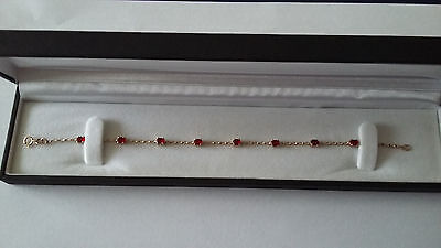 """9ct yellow gold with ruby. 7.5"""" long. Brand new & boxed"""
