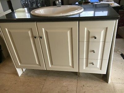 White vanity with basin and mixer tap