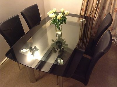 Solid Glass 2 Tier Dinning Table And Chairs