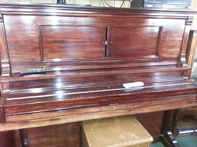 Vintage Pianola and Pianola cabinet with pianola rolls