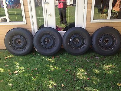 Winter Tires 4 Toyo open country 215/75R16 with rims. Used