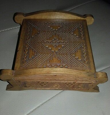 Small carved jewelry box shaped like a bed
