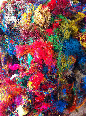 Silk waste fibres. Silk fibres left over from sari mills in India. Multicoloured