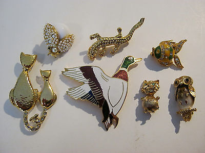 Small lot of 7 goldtone brooches, animals, fish, birds