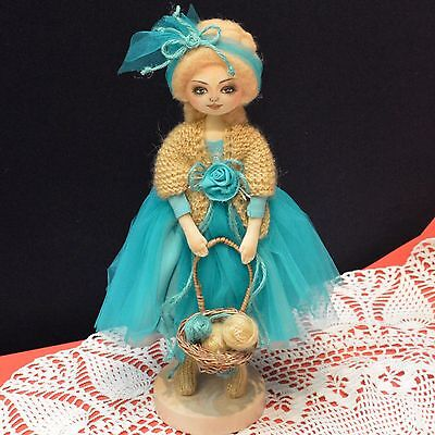Textile artist doll in a turquoise dress, 13 ¾in.