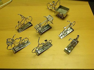 7 Hand Made miniature bicycles, chrome finished