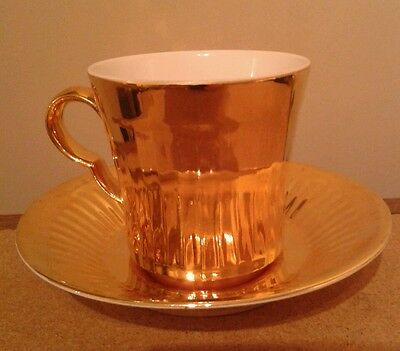 Royal worcester porcelain cup and saucer made in England shiny gold
