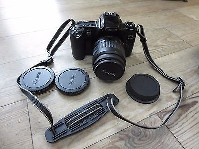 Canon EOS 3000 35mm SLR film camera with 35-80 mm lens and instruction booklet