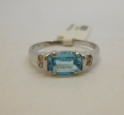 9ct white gold oval blue topaz and diamond engagement dress ring with hallmark