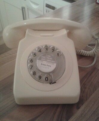 Vintage rotary dial telephone cream
