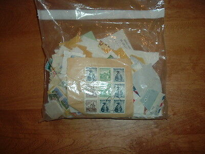 worldwide envelope of used stamps about 200 or more grams #8