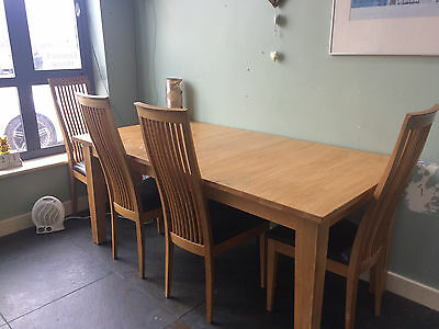 Solid Oak Extendable Dining Table And 4 High Back Chairs With Faux Leather Seats