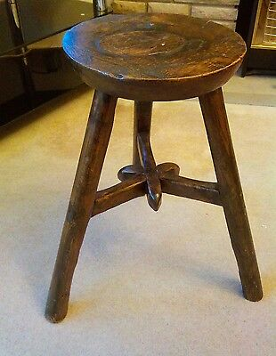 17 century oak and yew  three lagged milking stool with mortise and tenon joint.