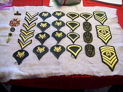 Lot of 26 U.S. Army shoulder rank patches, 5 medallions