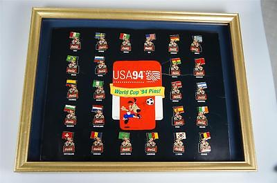 Coca Cola 1994 World Cup Pin Badges.Complete set mounted on Offical Board.