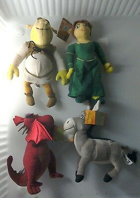 4 x Shrek 2 toys with labels attached
