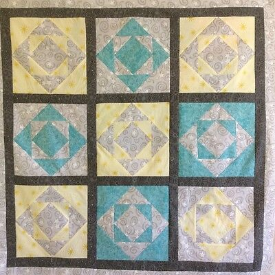 Handmade yellow and turquoise baby quilt