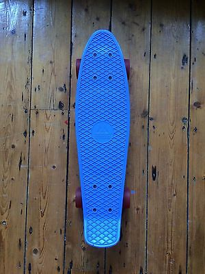 Blue penny board by Brighton Skateboards red wheels