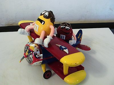 M & M's  AEROPLANE SWEET CANDY DISPENSER WITH RED AND YELLOW FIGURES