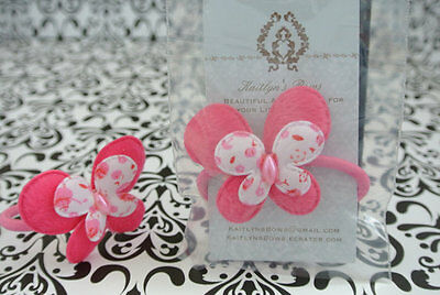 Pink butterfly with flower print hair tie