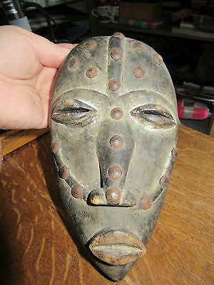 Vintage African Hand Carved Wall Tribal Mask with metal studs, unusual.