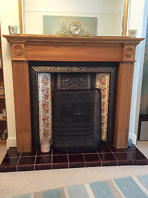 Wooden fireplace surround with cast iron and tile insert