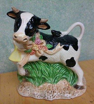 Ceramic Black & White Cow Figurine Statue Jumping On Green Grass W/ Flowers