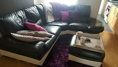Black and cream  leather right hand corner sofa from DFS + ottoman with storage