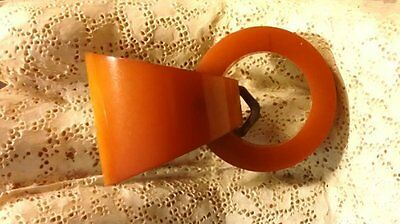 Vintage butterscotch colored triangle and circle dress clip