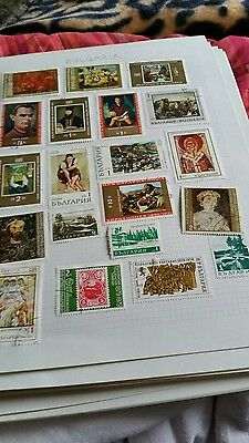 vintage Bulgarian  postage stamps attached to page by stamp hinges