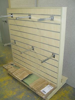 Slat wall display stand on wheels with glass shelves.  Double sided.