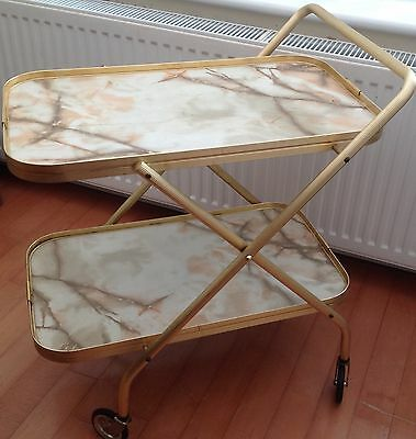 Vintage drinks trolley. Marble effect with gold coloured frame.