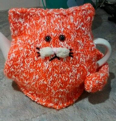 Hand-knitted ginger cat tea cosy for small/medium teapot.