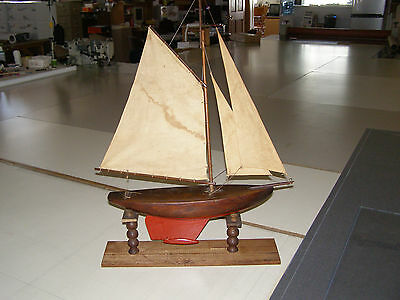 "Antique wooden model ""Gaff-rigged"" sailboat with stand 30"" tall by 22"" wide"