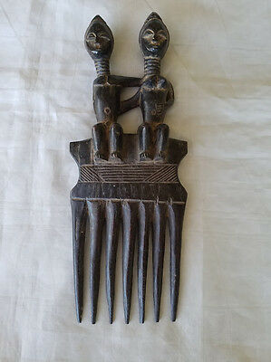"""Carved Baule wooden hair comb couple sitting arms outstretched behind 11"""" total"""