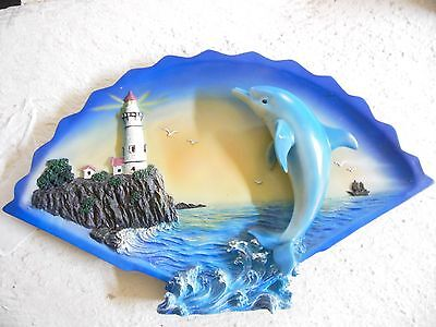 ceramic raised 3d dolphin plaque with ocean and light house