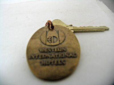 Vintage Brass Hotel Key and Fob Western International Hotels #927 on Fob