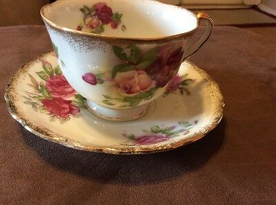 Bone china tea cup and saucer made in Japan Roses, Gold Trim