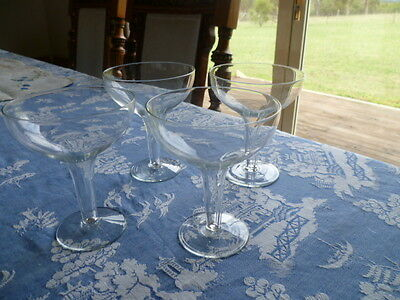 4  x clear champagne hollow stemmed glasses