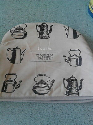 tea cosy. coffee pot cover. booths. beige colour.