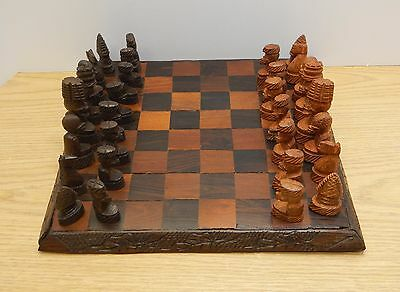 Vintage primitive carved chess board  with pieces figures African wooden