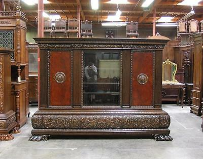 66018 : Large Antique Carved German Bookcase With Heavy Base and Claw Feet