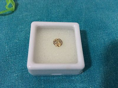 FAVOLOSA MOISSANITE FANCY BROWN  TONDA 0,57 CARATI mm 5,46