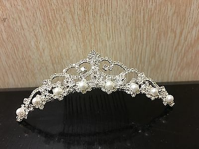 Elegant bridal tiara in silver colour with pearl and rhinestones