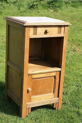 A FINE EARLY 20th CENTURY FRENCH OAK  BEDSIDE CABINET