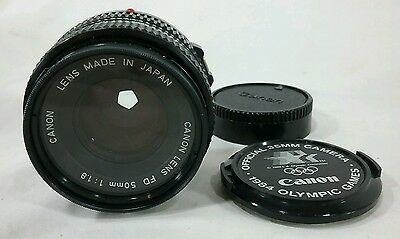 Canon 50mm f1.8 FD auto prime lens bundled with ex cond 1984 Olympic Games cap
