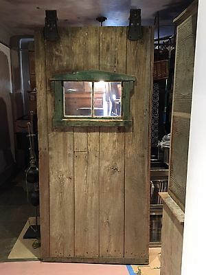 Antique Primitive Barn Door with Glass Window and Cast Iron Rollers