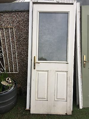 Back Door In Wood And Double Glazed Glass