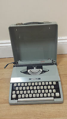 Authentic vintage Imperial Signet portable typewriter with case
