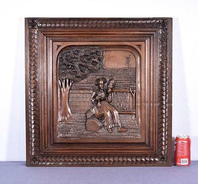 French Antique Breton (Brittany) Panel Chestnut Wood with a Seated Breton Woman